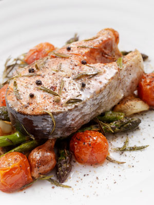 Fish with roasted tomatoes and asparagus.