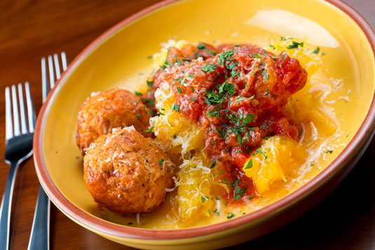 A plate of Spaghetti squash and meatballs