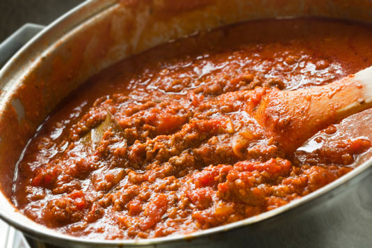 Meat sauce simmering in a pot.
