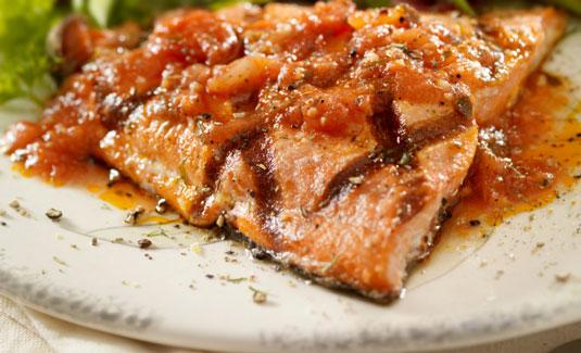 Salmon with fresh tomato sauce.