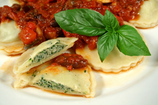 Spinach ravioli with a tomato and basil sauce.