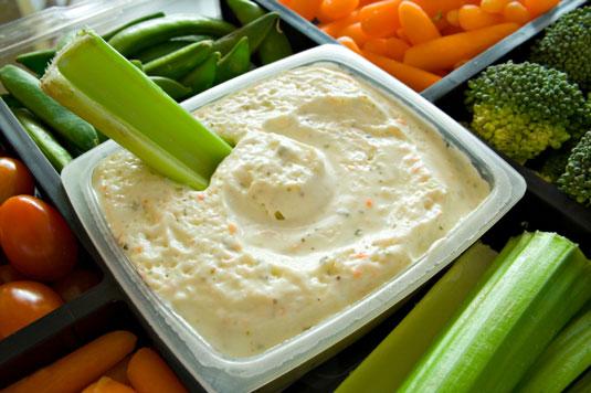 A bowl of veggies and dip.