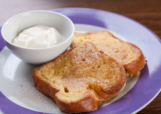 A plate of french toast with creme fraiche.