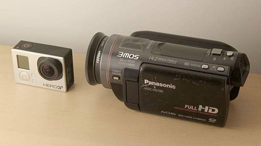 GoPro and Panasonic HD camcorder side by side.
