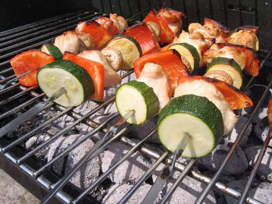 Barbecuing kebabs.