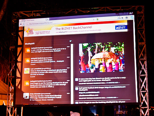 A live Twitter and Facebook stream on an outdoor screen.