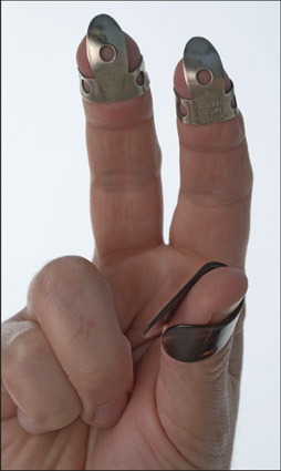 Proper positioning of the thumbpick and fingerpicks. [Credit: Photograph by Anne Hamersky]