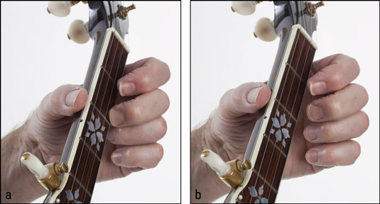 Playing a first‐string pull‐off: (a) fretting at the second fret and (b) pulling down w