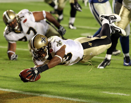 Pierre Thomas of the New Orleans Saints scores a touchdown against the Indianapolis Colts in Super