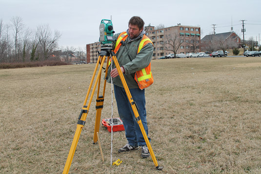 Site surveyors surveying land with traditional means. [Credit: Source: Elvert Barnes/Creative Commo