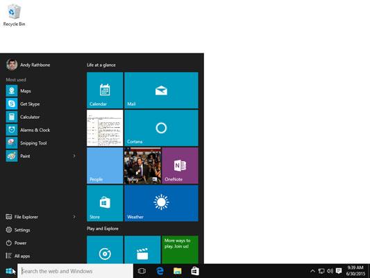 A desktop PC's Start menu stays in the screen's bottom-left corner.