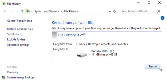 File History guesses as to which drive should store your backups.