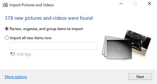 The Import Pictures and Videos window offers to copy your camera's files to your computer.