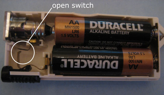 A switch in the open position disconnects the light bulb from the battery, creating an open circuit.