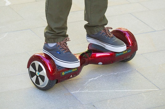 Riding a hoverboard just takes a little practice. [Credit: Image courtesy of cnet.com]