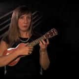 Woman playing the ukelele.