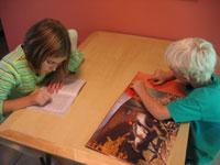 Two children reading.
