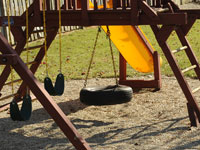 Old tires get a new life in a playground.