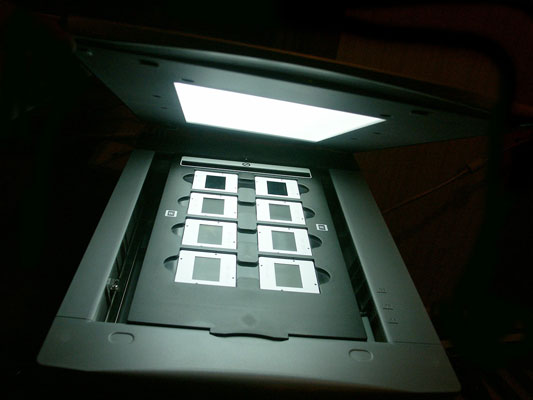 A flatbed scanner with a light source in its lid can scan film.