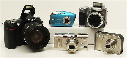 A Nikon digital SLR, or high-end, camera (left) along with a selection of more basic, and less expe