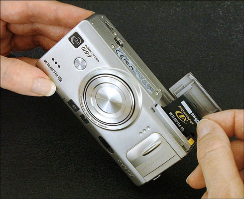 Insert your memory card into (or remove it from) your digital camera.