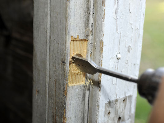 Bore a latchbolt hole on the doorjamb using a spade bit.