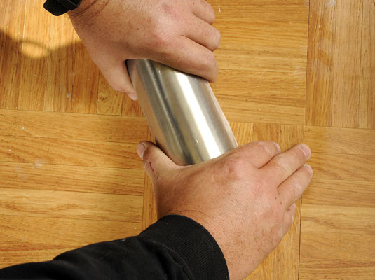 Roll the tile to get rid of any air pockets.