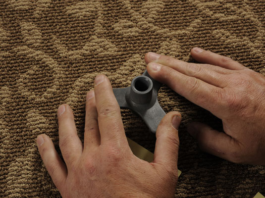 Push an alignment and depth control device into the carpet over the squeaky area.