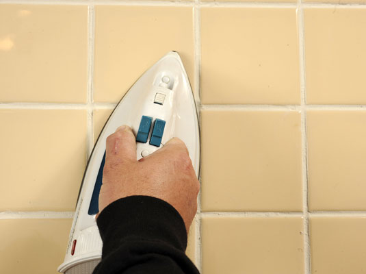 Warm The Tile With A Preheated Iron
