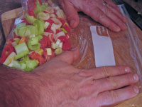 Putting the vegetables in a ziploc bag.