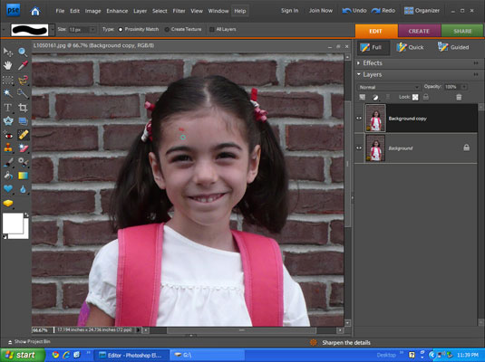 Using the healing brush tool to edit an image on Photoshop.
