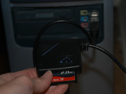 External card reader attached to the computer through a USB cable.