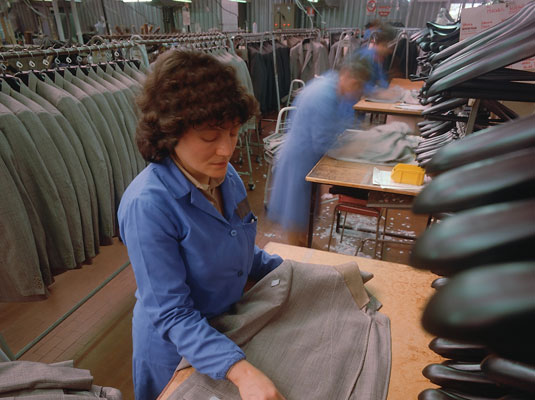 Workers in sweatshops make cheap clothes under sometimes unsafe and unsanitary conditions. [Credit: