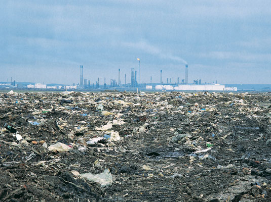 Incinerators can generate energy, but add pollutants as well. [Credit: Digital Vision]