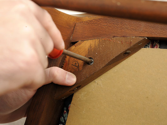 Remove The Seat Pad From The Chair By Removing The Screws That Hold It To  The Frame.