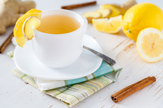 A cup of tea with lemon.