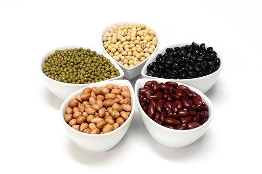 Five bowls filled with beans.