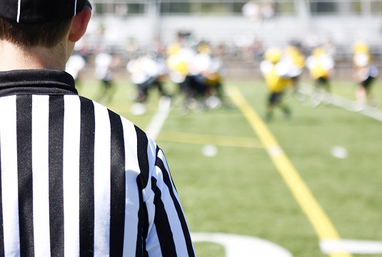 instant replay football official