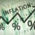 Word Inflation on up trend arrow, with financial data visible on the background.