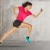 Sport woman starting running. young woman jogging front cement wall;